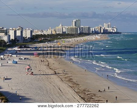 Miami, Florida, Usa--january 2018: Scenic View Of The South Beach Of Miami With Beachgoers On A Clou