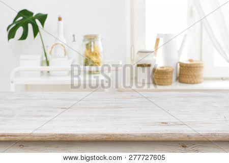Wooden Table Top On Blurred Kitchen Window And Shelves Background