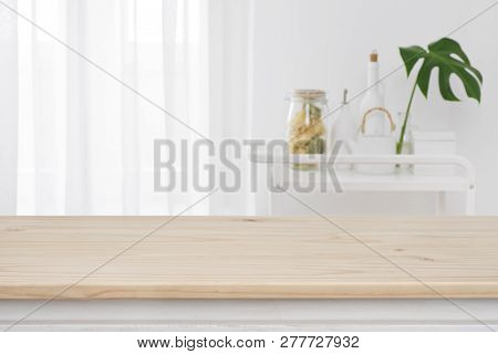 Blurred Kitchen Window, Shelves Background With Wooden Tabletop In Front