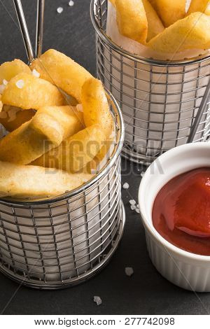 French Fries In A Serving Basket, Served With Spicey  Home Made Ketchup