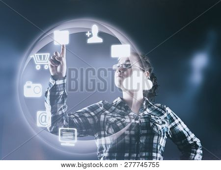 Woman Pressing On A Futuristic Menu With Icons.