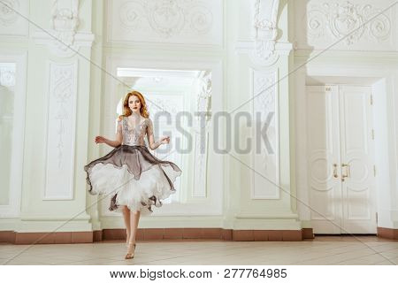 A full length portrait of a beautiful elegant woman in the evening dress. Fashion, evening dresses for events.