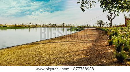 Pathway And Lake In The Love Lakes Dubai. A New Tourist Destination In The Vicinity Of Al Qudra Lake