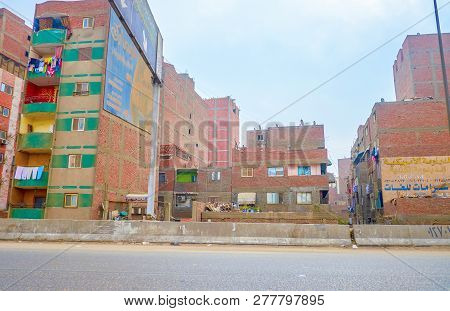 Cairo, Egypt - December 20, 2017: The Poor Neighborhood With Shabby Buildings In The Suburb Of Cairo