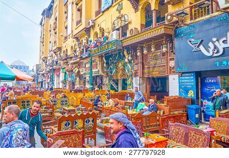 Cairo, Egypt - December 20, 2017: The Lines Of Traditional Restaurants With Colorful Carved Wooden S