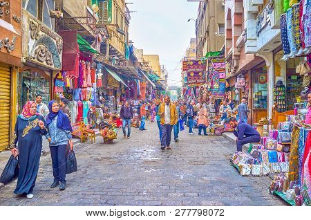 Cairo, Egypt - December 20, 2017: Two Arab Women Make Shopping In One Of Numerous Shopping Streets I