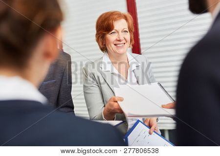 Personnel manager accepts application from candidate in assessment center