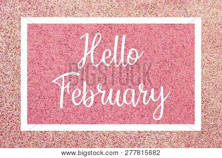 Hello February Greeting Card Message, White Text And Frame Against A Shiny Pink Glitter Background.