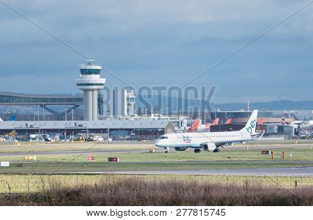 Gatwick Airport, England, Uk - December 09 2018: A Flybe Embraer E190 Plane Taxis After Landing At L