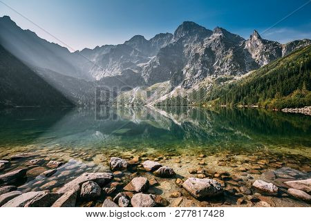 Tatra National Park, Poland. Famous Mountains Lake Morskie Oko Or Sea Eye Lake In Summer Morning. Be