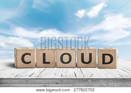 Cloud Computing Sign On A Table With White Clouds In The Background