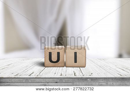 Ui Development Sign On A Desk In A Room With Bright Daylight