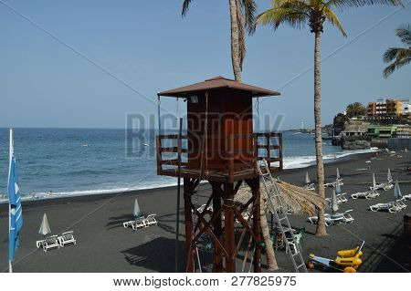 Picturesque Lifeguard Post On The Long Black Volcanic Sand Beach In Puerto Naos In The City Of Los L