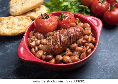 Cooked brown kidney beans stew with pork sausage