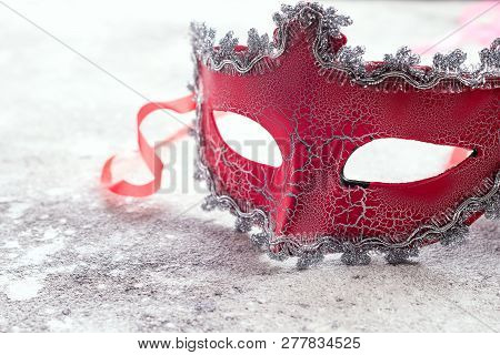 beautiful red carnival mask for carnival holiday background concept on stone, Human duplicity concept poster