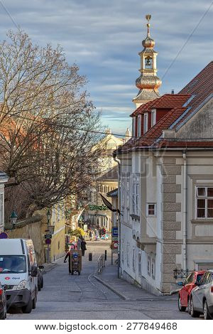 MOEDLING, AUSTRIA - DECEMBER 28, 2018. Historical center of the town of Moedling on a sunny winter day. View of the Town Hall tower. Town of Moedling, Lower Austria, Europe.