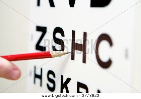 Pointing To A Vision Eye Test Chart