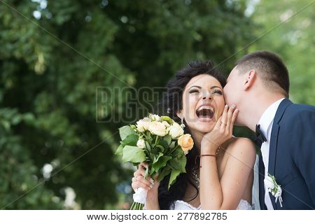 Bride And Groom At Wedding Day Outdoor On Spring Nature. Bridal Couple, Happy Newlywed Woman And Man