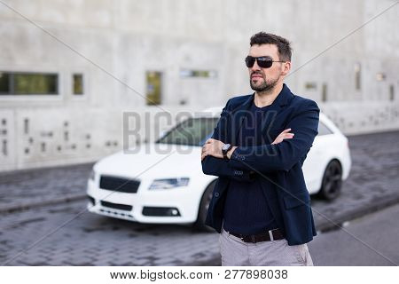Handsome Business Man Posing With His White Car