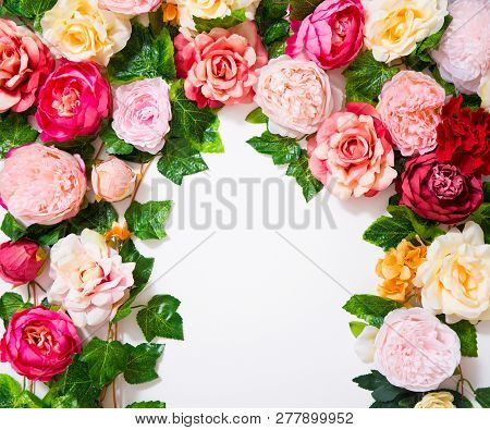 Spring And Summer Background - Close Up Of Colorful Artificial Flowers Over White Wall Background