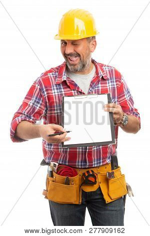 Goofy Constructor Indicating Blank Copyspace On Clipboard With Pen Isolated On White Studio Backgrou