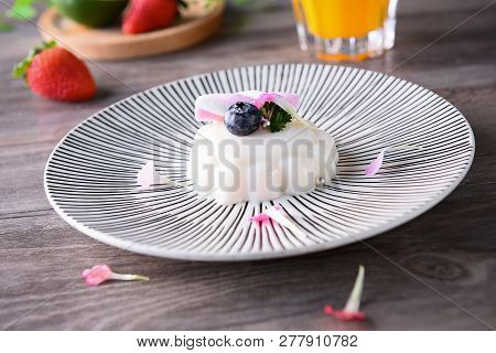 Blueberry Milk Pudding In A Ceramic Dish