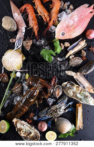 Fresh Seafood Set Meal With Ice In The Black Background