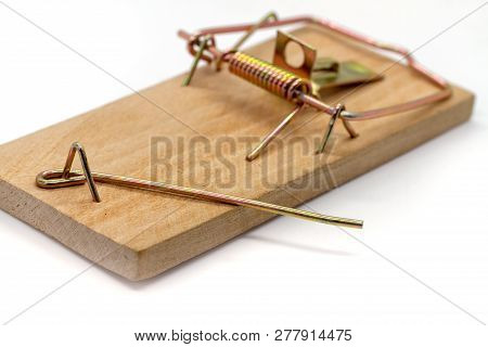 Wooden Home Mousetrap On A White Background. Selective Focus. Closeup Of An Unloaded Mouse Trap. Emp
