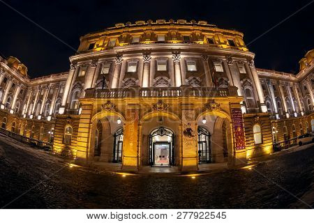 Budapest, Hungary - December 18, 2018: Night View Of Entrance From The National Szechenyi Library. W