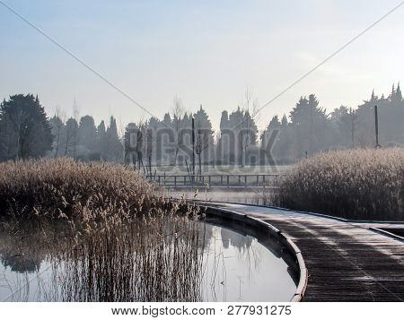 Background With Frozen Pier On A Winter Lake On A Calm Tranquil Winter Morning. Frost Hoar Wooden Wa