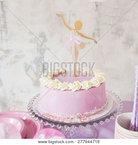 Ballerina Candy Bar. Delicious sweet buffet with cake. A beautiful buttercream layer cake decorated with ballerina cake topper. poster