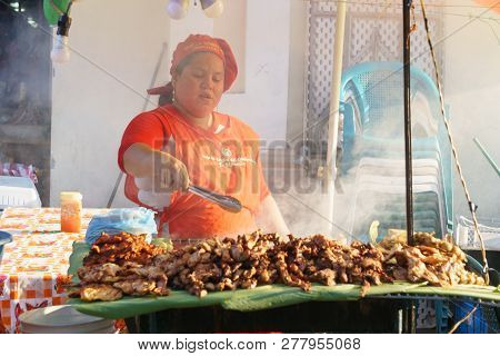 Leon, Nicaragua - March 10,2018: Nicaraguan Woman Cooking On The Street Typical Food