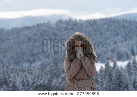 Girl In Mountain In Winter Vacations. Young Girl Skiing In Winter Vacation. Girl In Mountain Vacatio