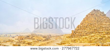 The Foggy Winter Morning In Giza Archaeological Complex With Ruins Of Ancient Pyramids On The Backgr