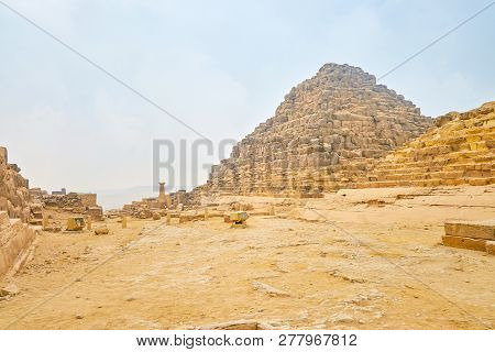 The Ruins Of Small Pyramids Of The Queens In The Arhceoligical Site Next To The Great Pyramid Of Giz