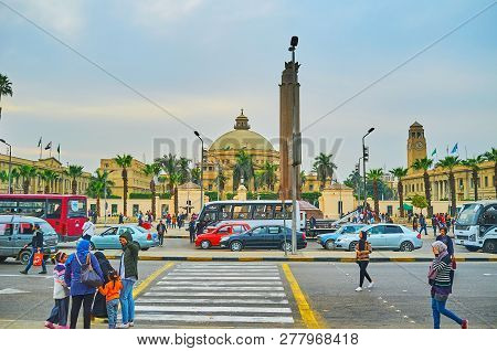 Giza, Egypt - December 19, 2017: The Busy Bus Station In Front Of The Building Of Faculty Of Arts Of