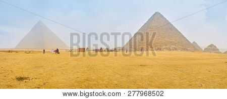 Giza, Egypt - December 20, 2017: Pyramids Of Giza Are The Center Of Tourist Life And The Must See Pl