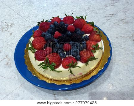The Dish With Cheesecake On The Background