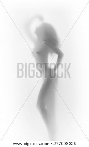 Beautiful Any Sexy Womand Naked Stands Behind A Glass Or Textile Surface. Body Silhouette Can Be See