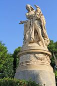 Public XIX century sculpture of the famous British poet Lord Byron crowned by personification of Greece in the National Garden in Athens, Greece with blue sky copy space. poster