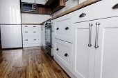 Stylish kitchen interior design. Luxury modern kitchen furniture in grey color and steel oven,fridge, sink, wooden tabletop. Gray cabinets in scandinavian style. Home renovation t-shirt