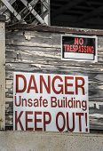Danger Unsafe Building, Keep Out! and No Trespassing Signs poster