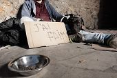 Beggar and dog sitting next to alms bowl on street poster
