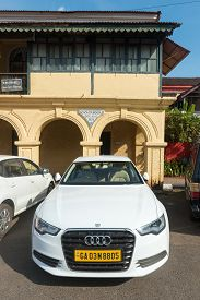 Goa, India - Dec 18, 2018: An Audi Car Parked Outside An Old Portuguese Style House In Goa, India On