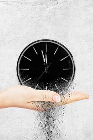 3d Illustration Of Classic Clock On White Concrete Background Disintegrate In A Small Parts And Flow