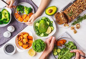 Healthy Vegan Food Lunch, Top View. Vegetarian Dinner Table, People Eat Healthy Food. Salad, Sweet P
