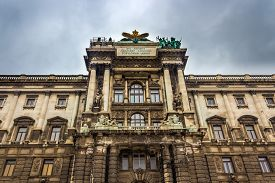 Vienna / Austria -  October 10 2014:  Neue burg close up, the new part of the Hofburg palace.The inscription in latin means In this building I reconciled the love of the nations