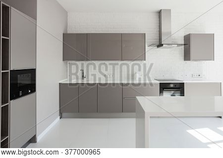 Facade Of New Modern House With Contemporary Interior Design In Bright White Kitchen, Cabinet Furnit