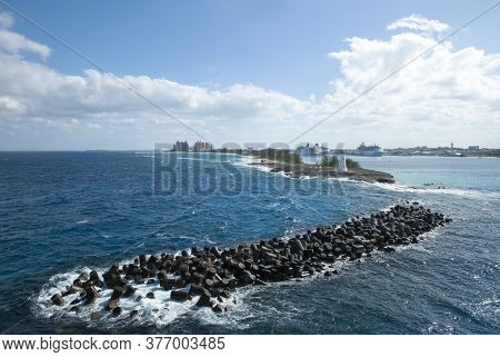 The View Of Paradise Island With A Lighthouse And Nassau Harbour With Cruise Ships (bahamas).