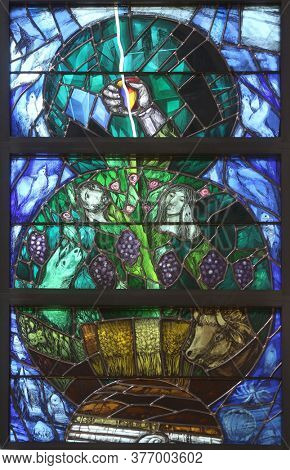 PIFLAS, GERMANY - JUNE 07, 2015: God leads his own to completion in all his glory, stained glass window by Sieger Koder in church of Saint John in Piflas, Germany